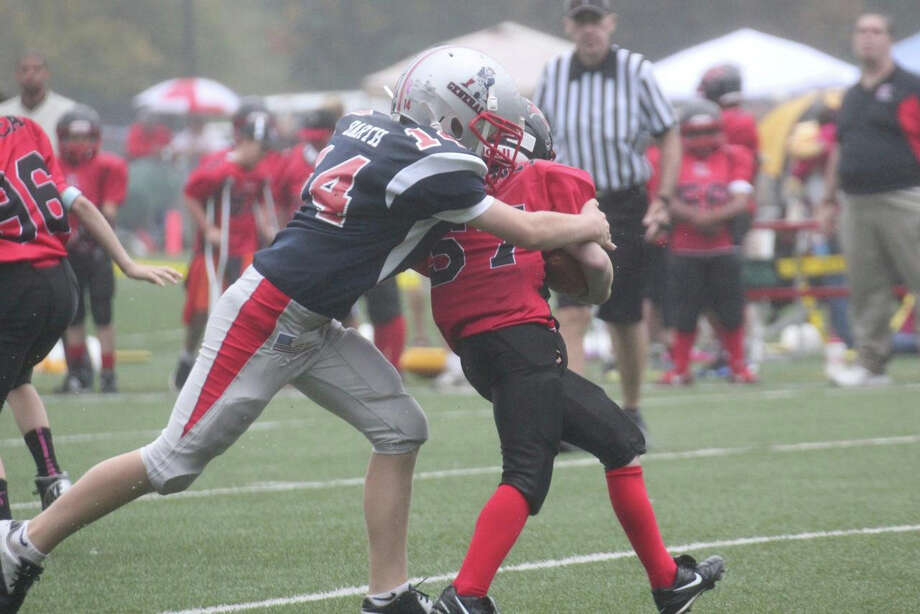 The Generals' Harrison Barth takes down a BANC running back. October 2013. Photo: Contributed Photo