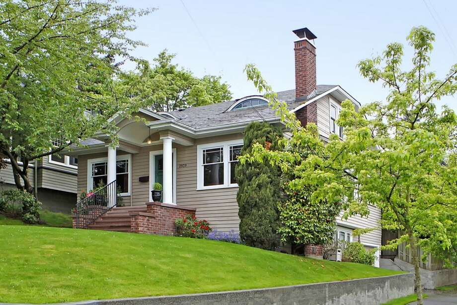 Front of 2939 Mayfair Ave. N. The 2,920-square-foot house, built in 1923, has four bedrooms, two bathrooms, built-ins, exposed woodwork, crown moldings, French doors and a back deck on a 4,000-square-foot lot. It's listed for $658,888. Photo: ImageArts Photography,  Maynard Wagner, RE/MAX On The Lake