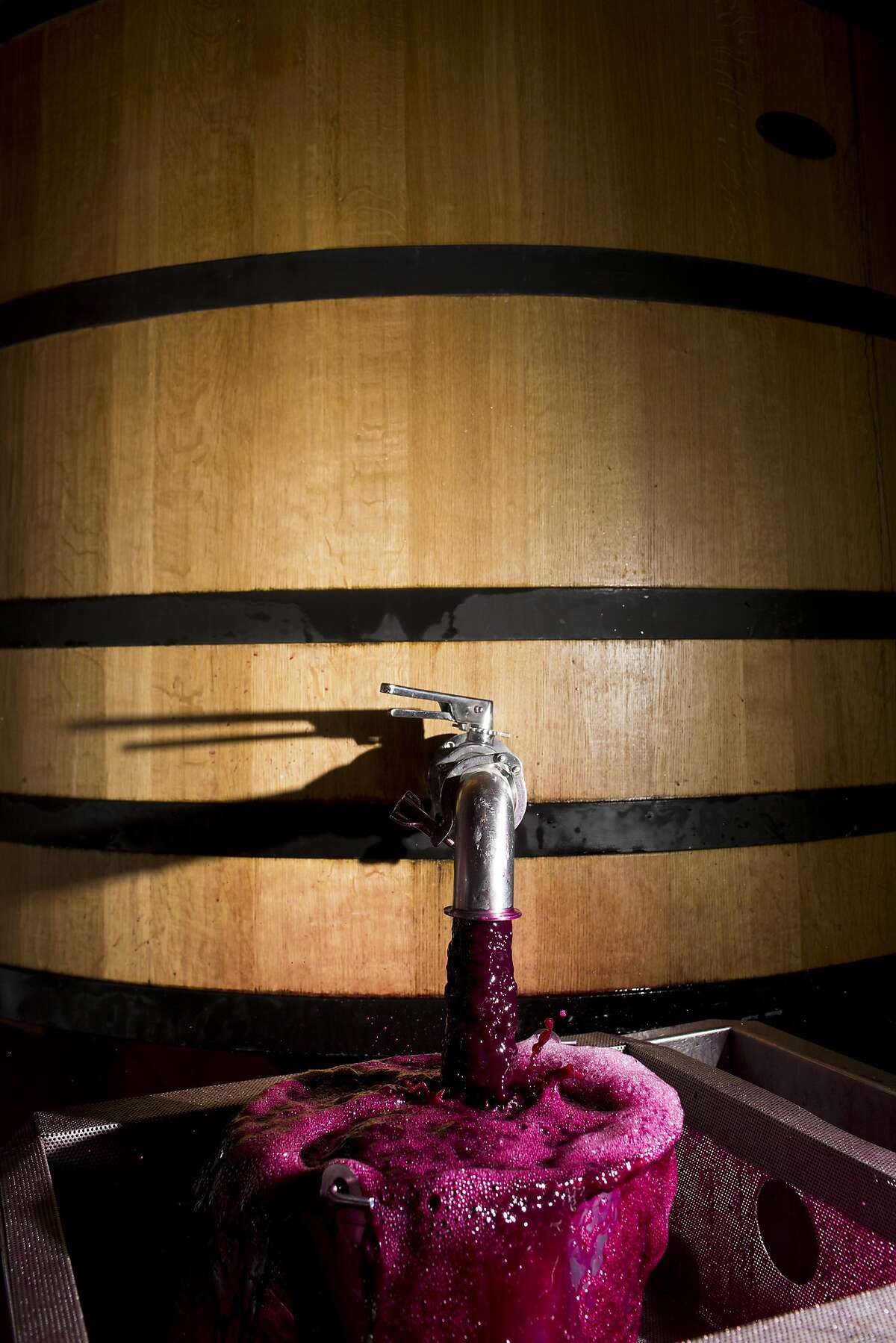 Wine being warmed in a large fermenting tank at Spring Mountain Vineyard in St. Helena, Calif., Friday, October 4, 2013.