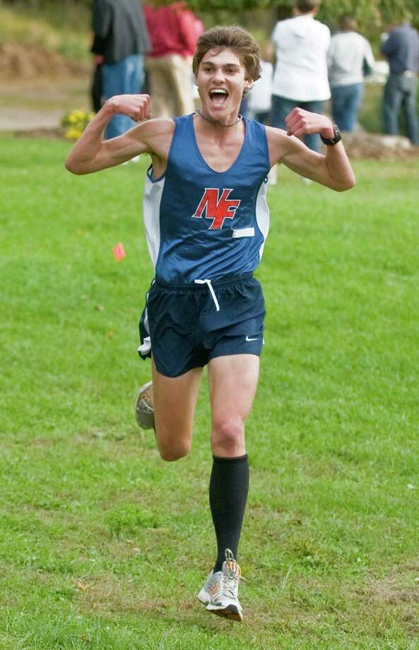High school boys cross-country race winner Zach Anderson of New Fairfield High School finishing at Tarrywile Park in Danbury. Tuesday, Oct. 8, 2013 Photo: Scott Mullin / The News-Times Freelance