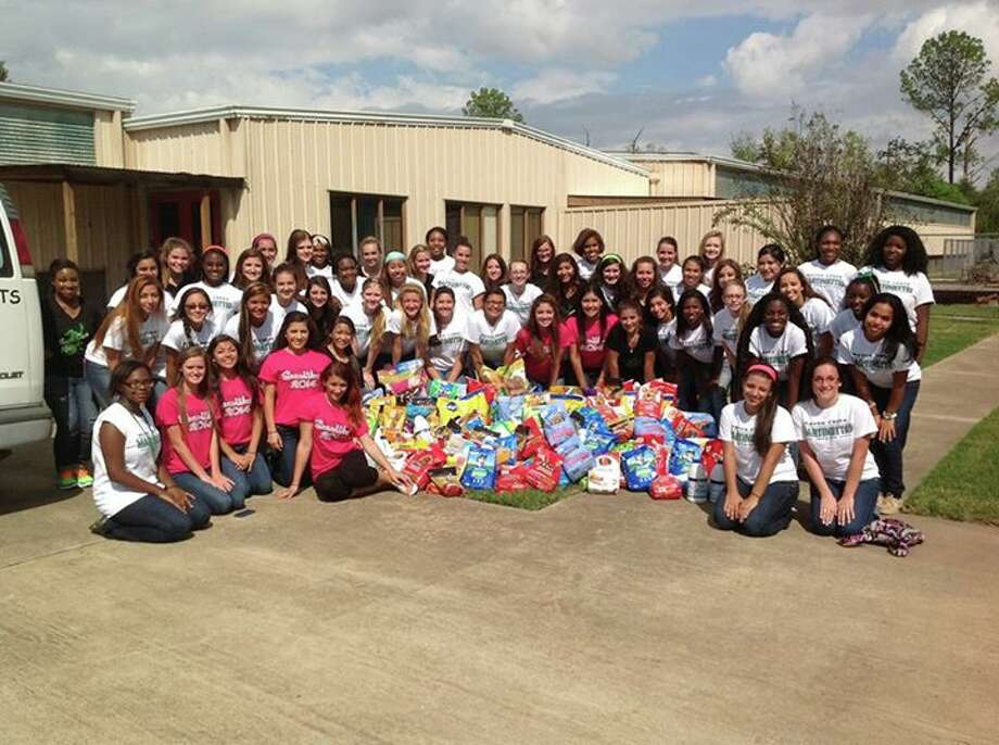 Members of the Mayde Creek High School drill team recently collected food, cleaning supplies and money for Special Paws. Photo: Courtesy Of Mayde Creek High School