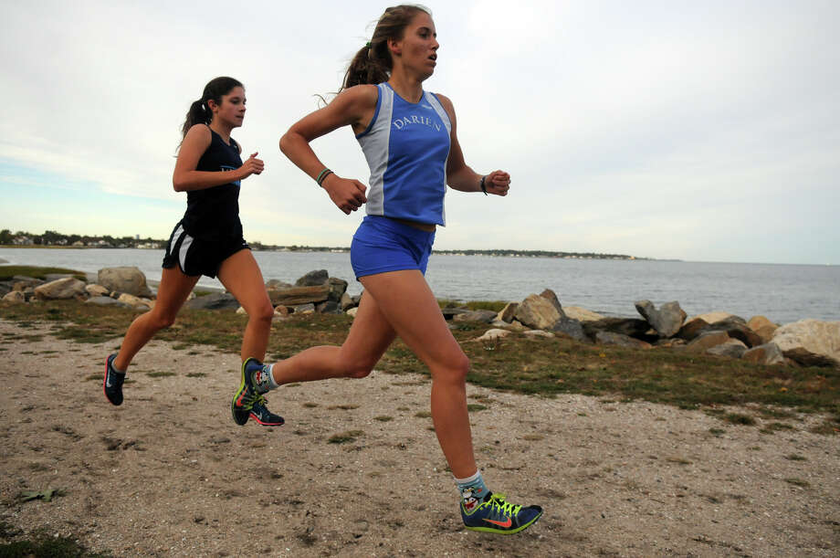 Darien's Anne Johnston leads the pack as she heads to a win as Wilton, Norwalk, Darien and Greenwich High Schools girls cross country teams meet for a race at Greenwich Point in Greenwich, Conn., Oct. 8, 2013. Photo: Keelin Daly / Stamford Advocate Freelance