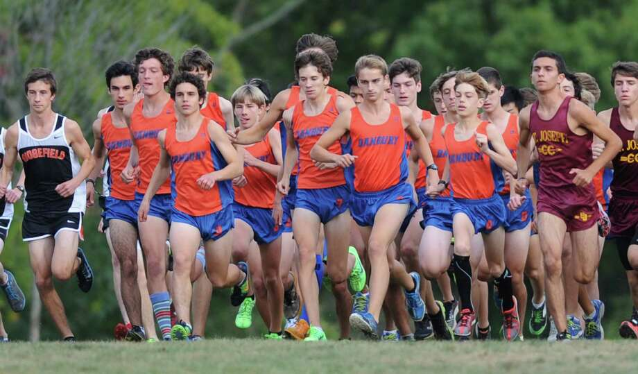 The Danbury boys team leaves the starting line in the FCIAC high school cross country meet between New Canaan, Danbury, Ridgefield, St. Joesph and Trinity Catholic at the Waveny Park course in New Canaan, Conn. on Tuesday, Oct. 8, 2013. Photo: Tyler Sizemore / The News-Times