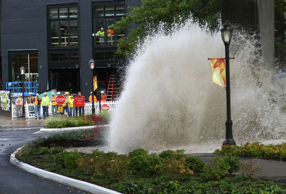 Water erupts from the ground after a main burst under the NE 45th Street Viaduct, flooding the streets of University Village on Tuesday, October 8, 2013. Stores and businesses in the popular shopping destination were spared from the flood of water. There was concern that the flood of water may have undermined the support structures of the bridge. Photo: JOSHUA TRUJILLO, SEATTLEPI.COM / SEATTLEPI.COM