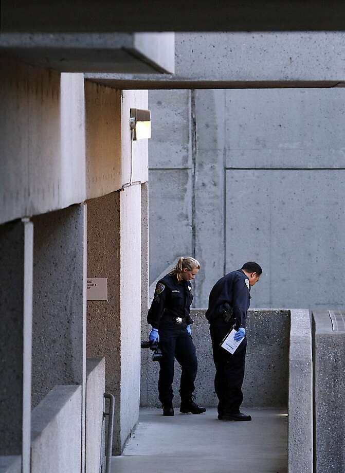 Police work outside the stairwell at San Francisco General Hospital where a woman's body was found in San Francisco, Calif., on Tuesday, October 8, 2013. Photo: Sarah Rice, Special To The Chronicle