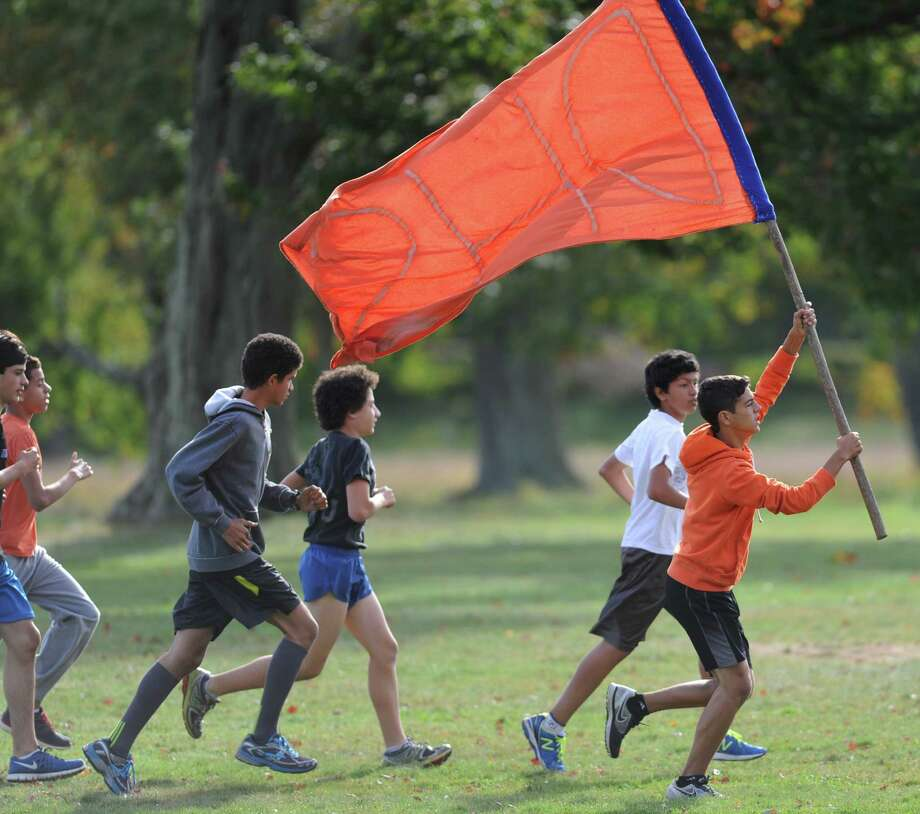 Photos from the FCIAC high school cross country meet between New Canaan, Danbury, Ridgefield, St. Joesph and Trinity Catholic at the Waveny Park course in New Canaan, Conn. on Tuesday, Oct. 8, 2013. Photo: Tyler Sizemore / The News-Times