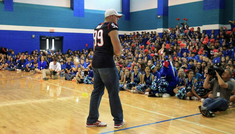 Houston Texans defensive end J. J. Watt speaks to children at a pep rally as the Texans and the American Heart Association kicked off the NFL PLAY 60 Challenge. Photo: Karen Warren, Houston Chronicle / © 2013 Houston Chronicle