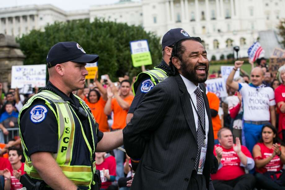 WASHINGTON, DC - OCTOBER 8: Rep. Al Green (D-TX) is arrested by U.S. Capitol Police after blocking First Street NW in front of the U.S. Capitol with fellow supporters of immigration reform, on October 8, 2013 in Washington, DC. Last week, House Democrats introduced their own immigration reform bill. (Photo by Drew Angerer/Getty Images) Photo: Drew Angerer, Getty Images