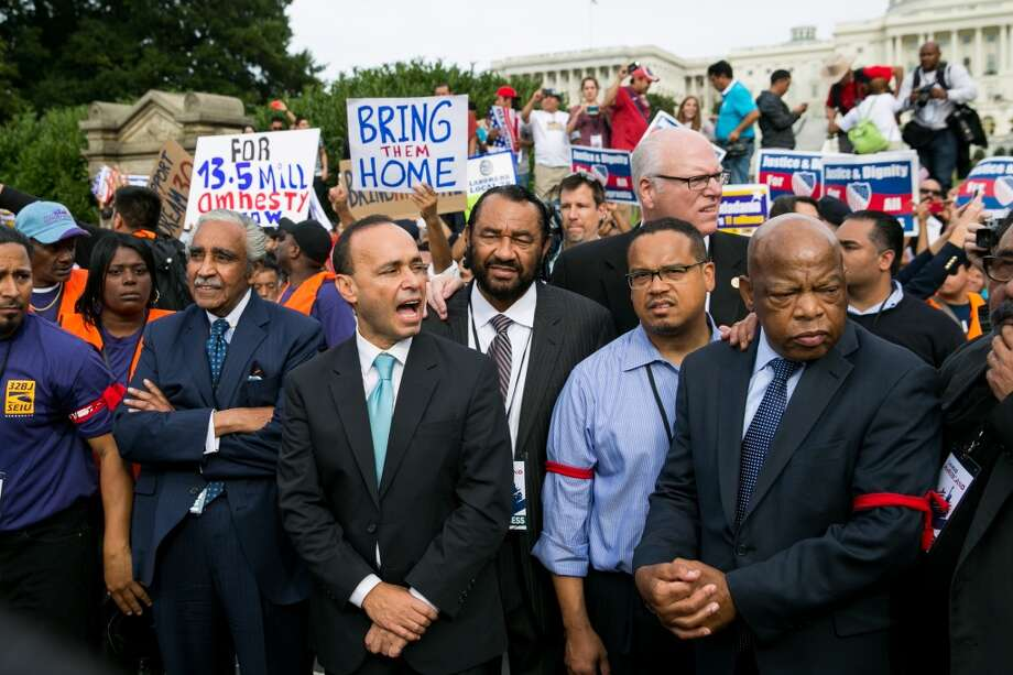 Green stands with fellow lawmakers: Rep. Charles Rangel (D-NY), Rep. Luis Gutierrez (D-IL), Rep. Keith Ellison (D-MN) and Rep. John Lewis (D-GA). Photo: Drew Angerer, Getty Images