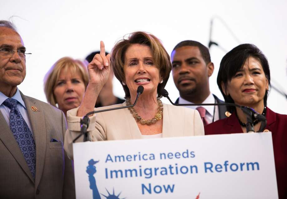 WASHINGTON, DC - OCTOBER 8:  House Minority Leader Rep. Nancy Pelosi (D-CA), center, speaks during a rally in support of immigration reform, in Washington, on October 8, 2013 in Washington, DC. Last week, House Democrats introduced their own immigration reform bill. (Photo by Drew Angerer/Getty Images) Photo: Drew Angerer, Getty Images