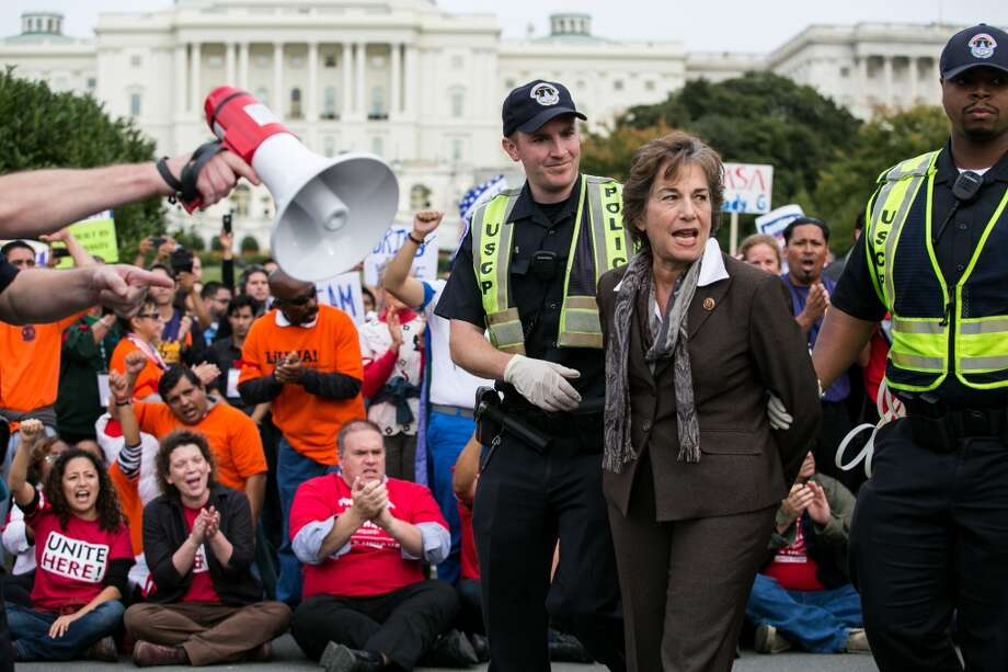 WASHINGTON, DC - OCTOBER 8: Rep. Janice Schakowsky (D-IL) is arrested by U.S. Capitol Police after blocking First Street NW in front of the U.S. Capitol with fellow supporters of immigration reform, in Washington, on October 8, 2013 in Washington, DC. Last week, House Democrats introduced their own immigration reform bill. (Photo by Drew Angerer/Getty Images) Photo: Drew Angerer, Getty Images