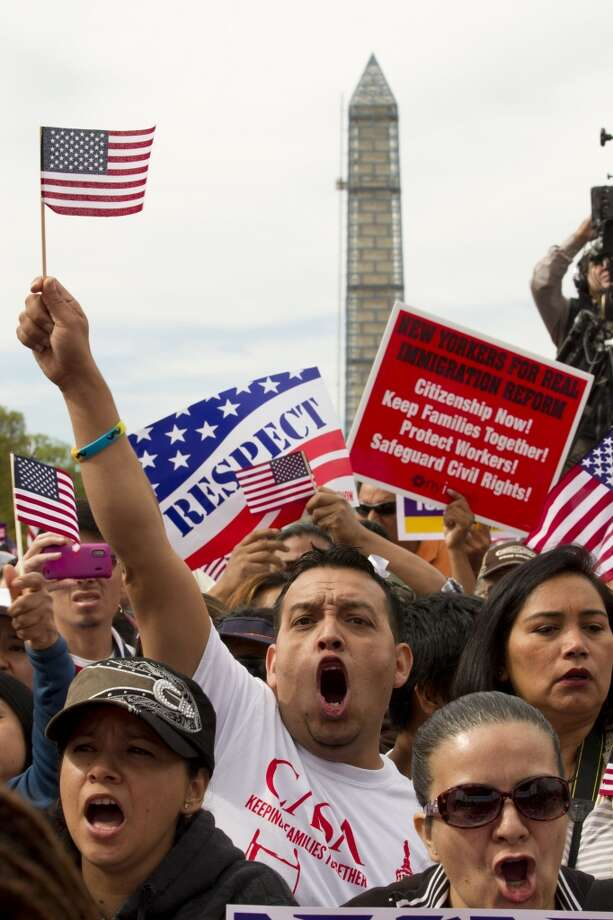 Demonstrators shout during a immigration a rally on the National Mall in Washington, Tuesday, Oct. 8, 2013, calling on the House Republican leadership to pass comprehensive immigration reform with a path to citizenship. The Washington Monument is in the background.  ( AP Photo/Jose Luis Magana) Photo: Jose Luis Magana, Associated Press