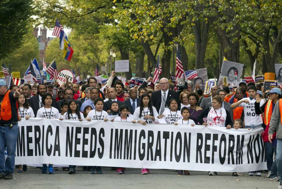 Demonstrators march towards on Capitol Hill during a immigration rally in Washington, on Tuesday, Oct. 8, 2013, seeking to push Republicans to hold a vote on a stalled immigration reform bill. ( AP Photo/Jose Luis Magana) Photo: Jose Luis Magana, Associated Press