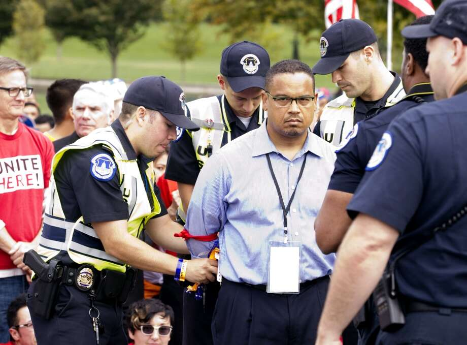 Rep. Keith Ellison D-Minn., is arrested by U.S. Capitol Police officers on Capitol Hill during a immigration rally in Washington, on Tuesday, Oct. 8, 2013.. ( AP Photo/Jose Luis Magana) Photo: Jose Luis Magana, Associated Press