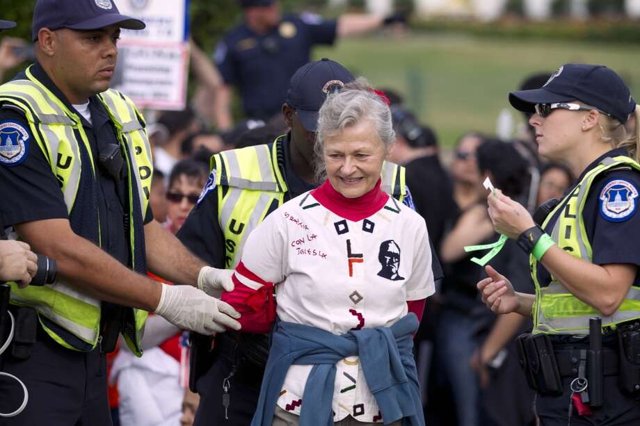 A demonstrator is arrested by U.S. Capitol Police officers on Capitol Hill during a immigration rally in Washington, on Tuesday, Oct. 8, 2013, seeking to push Republicans to hold a vote on a stalled immigration reform bill. (AP Photo/Jose Luis Magana) Photo: Jose Luis Magana, Associated Press