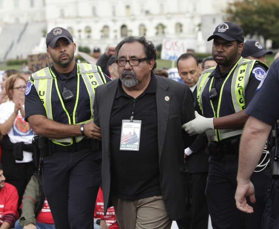 Raul Grijalva(D-AZ) is arrested on Capitol Hill in an act of civil disobedience to encourage support of immigration reform, October 8, 2013 on The National Mall in Washington DC. Thousands marched on Capitol Hill and called on Congress to adopt an immigration law that would allow the nation's 12 million undocumented immigrants the ability to apply for US citizenship. AFP PHOTO / Chris KleponisCHRIS KLEPONIS/AFP/Getty Images Photo: CHRIS KLEPONIS, AFP/Getty Images