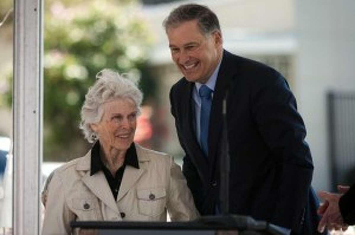 Governor Jay Inslee, right, laughs with Bullitt Foundation board member Harriet Bullitt.