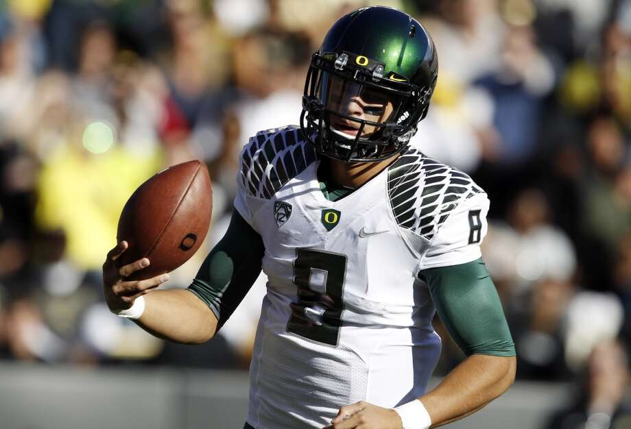 3. Marcus Mariota, 6-4, 212, Soph., Oregon  His stock is on the rise because he's so gifted and continues to show improvement.  2013 stats so far: 1,358 passing yards, 14 touchdowns, 0 interceptions, 56.7 completion percentage, 338 rushign yards, 7 rushing touchdowns Photo: David Zalubowski, Associated Press
