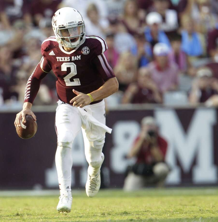 5. Johnny Manziel, 6-0, 210, Soph., Texas A&M  Incredible runner and improviser who has improved tremendously as a passer.  2013 stats so far: 1,489 passing yards, 14 touchdowns, 4 interceptions, 71.4 completion percentage, 314 rushing yards, 3 rushing touchdowns Photo: Karen Warren, Houston Chronicle