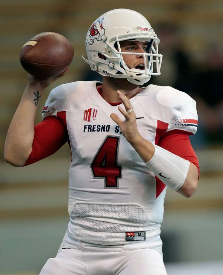 8. Derek Carr, 6-3, 215, Sr., Fresno StateThe younger brother of David Carr has the smarts and big arm the scouts like to see.  2013 stats so far: 1,864 passing yards, 19 touchdowns, 4 interceptions, 70.7 completion percentage Photo: William Mancebo, Getty Images