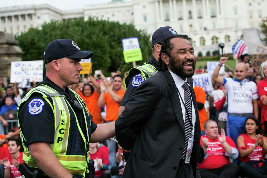 Rep. Al Green of Houston was arrested Tuesday by U.S. Capitol Police after blocking a street with fellow supporters of immigration reform. Photo: Drew Angerer, Stringer / 2013  Getty Images
