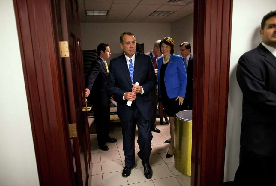 House Speaker John Boehner of Ohio, followed by Rep. Cathy McMorris Rodgers, R-Wash., and House Majority Leader Eric Cantor of Va., leaves a House Republican conference meeting, for a news conference on Capitol Hill in Washington, Tuesday, Oct. 8, 2013. Democrats controlling the Senate plan to move quickly toward a vote to allow the government to borrow more money, challenging Republicans to a filibuster showdown as the time remaining to stop a first-ever default on U.S. obligations ticks by.   (AP Photo/ Evan Vucci) ORG XMIT: DCEV106 Photo: Evan Vucci / AP