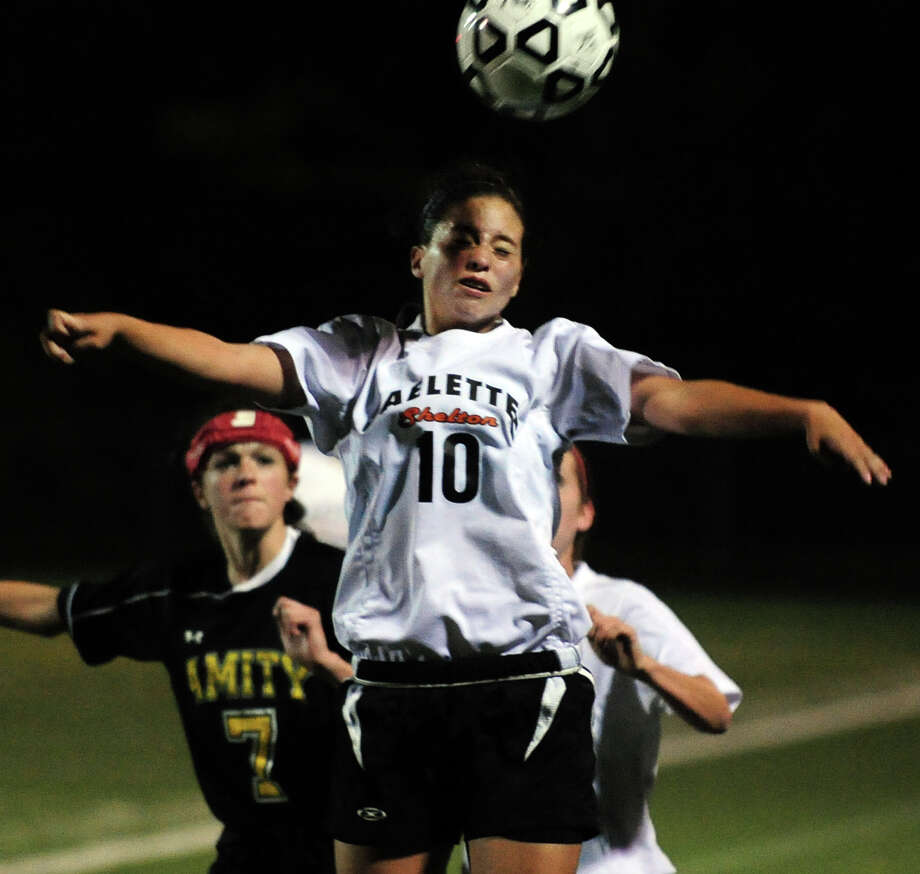 Shelton's Marlee Figueroa heads the ball, during girls high school soccer action against Amity in Shelton, Conn. on Tuesday October 8, 2013. Photo: Christian Abraham / Connecticut Post