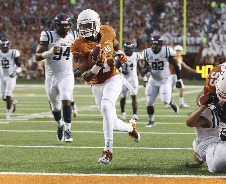 UT receiver Mike Davis reiterated that he wasn't trying to hurt anyone with his cut block. Photo: Kin Man Hui / Express-News