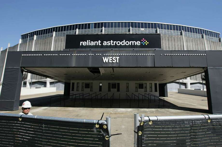 The site work and removal of ticket booths, concrete stairs, ramps and transmission lines has begun at Reliant Astrodome the 8th Wonder of the World Tuesday, Oct. 8, 2013, in Houston. Photo: James Nielsen, Houston Chronicle / © 2013  Houston Chronicle