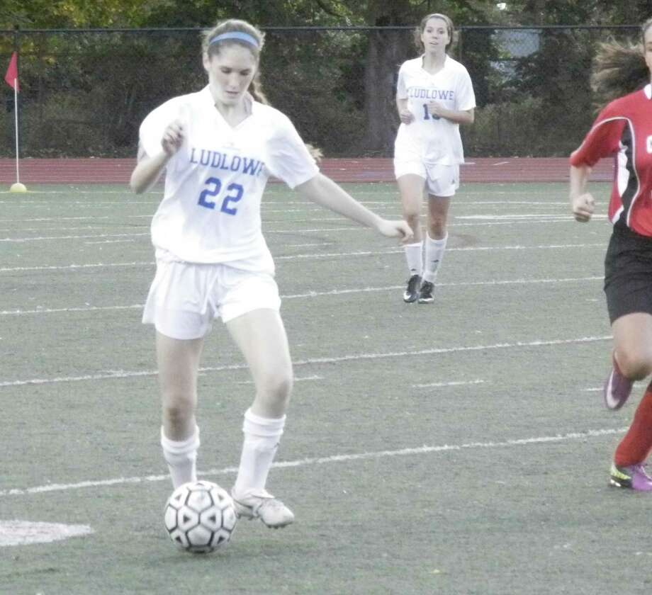 Caroline Rooney (22) controls the ball in the first half of Fairfield Ludlowe's 6-0 win over Bridgeport Central in girls soccer on Tuesday, Oct. 8 in Fairfield. Photo: Reid L. Walmark / Fairfield Citizen