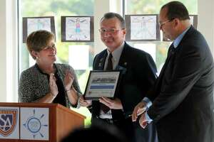 Deborah Rausch, executive director of the Capital Region Maritime Center, left, and Michael Christensen, founder and Head of School, right, present a plaque to Pete Bardunias, president and CEO of the Chamber of Southern Saratoga County, during the opening of the Saratoga Academy for Leadership and Maritime Programs on Tuesday, Oct. 8, 2013, at the Capital Region Maritime Center in Alplaus, N.Y. (Cindy Schultz / Times Union)