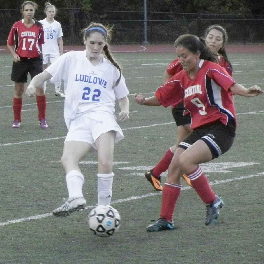 Caroline Rooney (22) is challenged by Bridgeport Central's Suny Lang (9) in Fairfield Ludlowe's 6-0 win over Bridgeport Central in girls soccer on Tuesday, Oct. 8 in Fairfield. Photo: Reid L. Walmark / Fairfield Citizen