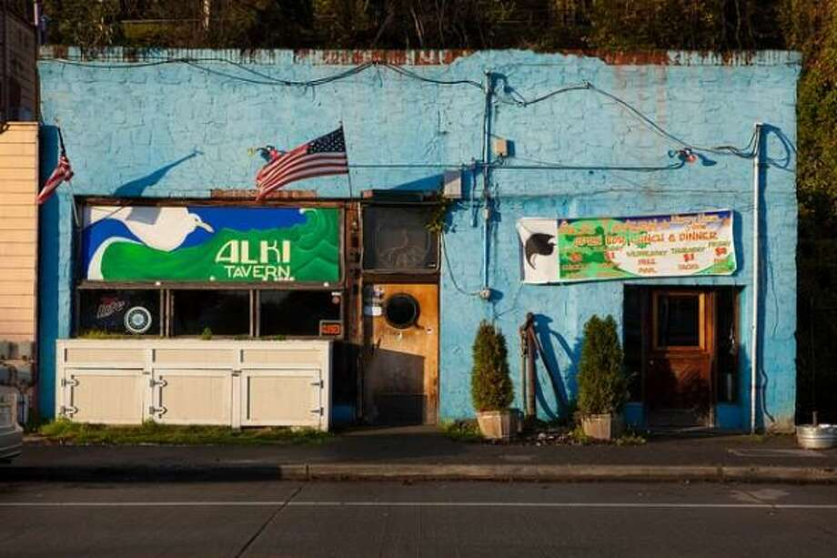 For more than three decades, the Alki Tavern was West Seattle's most famous dive bar with a view. But the Taco Thursdays and biker regulars bid farewell in March of 2013, when the bar closed to make way for condos. Photo: aturkus, Flickr. Photo: Aturkus, Flickr