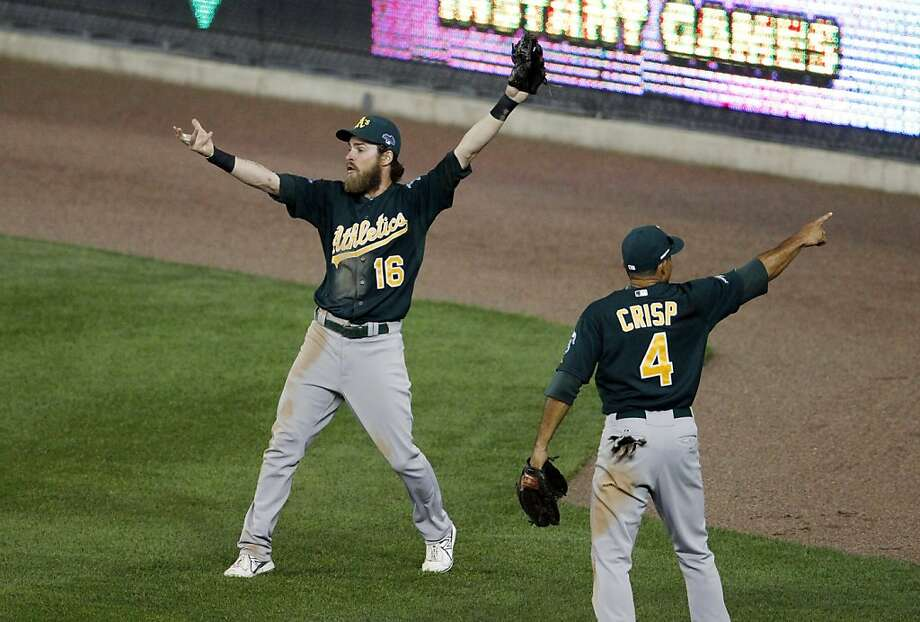 Josh Reddick and Coco Crisp launch their appeals for overturning a home run call and ruling it fan interference. Photo: Duane Burleson, Associated Press