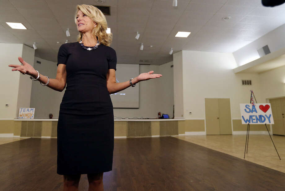 Wendy Davis has spent two days getting to know San Antonio. On Monday (above) she took questions at the Firefighters Banquet Hall. Yesterday, she was at the Intrepid center. Photo: Edward A. Ornelas / San Antonio Express-News