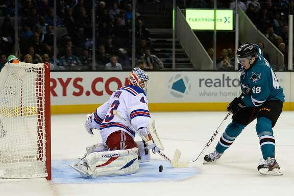 SAN JOSE, CA - OCTOBER 08:  Tomas Hertl #48 of the San Jose Sharks gets his shot past goalkeeper Martin Biron #43 of the New York Rangers scoring his second goal of the second period at SAP Center on October 8, 2013 in San Jose, California.  (Photo by Thearon W. Henderson/Getty Images)