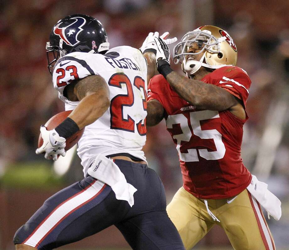 Texans running back Arian Foster tries to get past 49ers cornerback Tarell Brown. Photo: Brett Coomer, Houston Chronicle