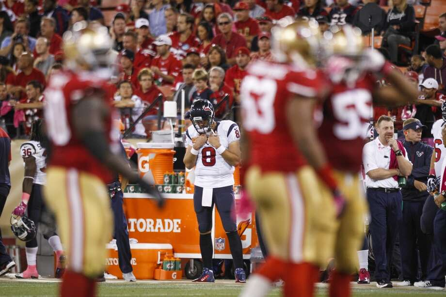 Texans quarterback Matt Schaub drops his head after being benched during the fourth quarter. Photo: Brett Coomer, Houston Chronicle