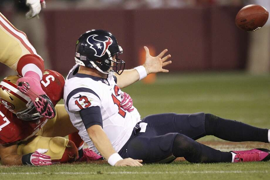 Texans quarterback T.J. Yates loses the ball after being sacked by 49ers linebacker Michael Wilhoite during the fourth quarter. The play was ruled down before the apparent fumble. Photo: Brett Coomer, Houston Chronicle