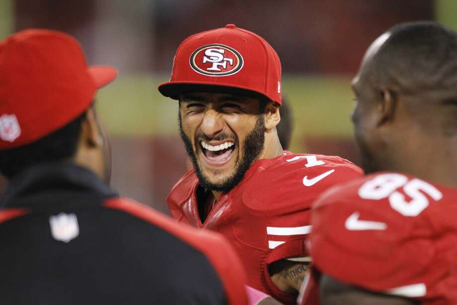 49ers quarterback Colin Kaepernick laughs on the sidelines during the fourth quarter. Photo: Brett Coomer, Houston Chronicle
