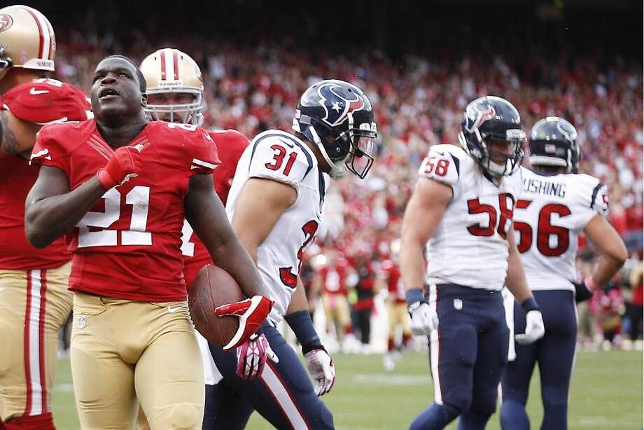 49ers running back Frank Gore celebrates after scoring on a 1-yard touchdown run. Photo: Brett Coomer, Houston Chronicle