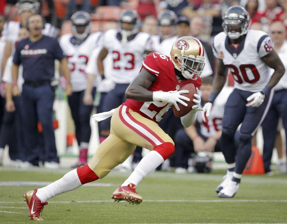 49ers defensive back Tramaine Brock takes a pass intended for Texans wide receiver Andre Johnson and returns it for a touchdown. Photo: Carlos Avila Gonzalez, San Francisco Chronicle