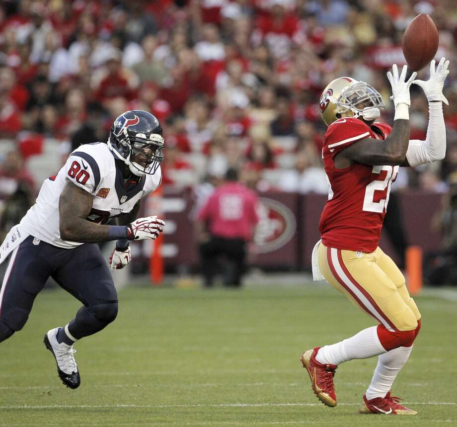 49ers defensive back Tramaine Brock intercepts a pass intended for  Texans wide receiver Andre Johnson during the second quarter. Photo: Carlos Avila Gonzalez, San Francisco Chronicle