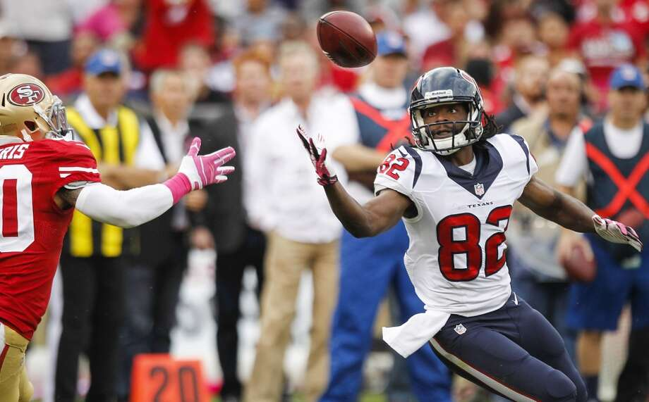 Texans wide receiver Keshawn Martin reaches for a pass as 49ers defensive back Darryl Morris defends. Photo: Brett Coomer, Houston Chronicle