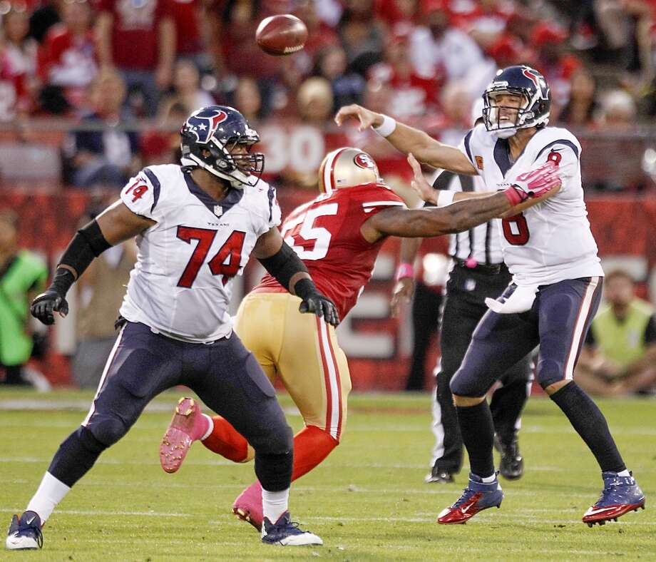 Texans quarterback Matt Schaub gets off a pass as 49ers outside linebacker Ahmad Brooks applies pressure. Photo: Brett Coomer, Houston Chronicle