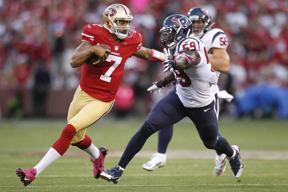 49ers quarterback Colin Kaepernick gets past Texans outside linebacker Whitney Mercilus. Photo: Brett Coomer, Houston Chronicle