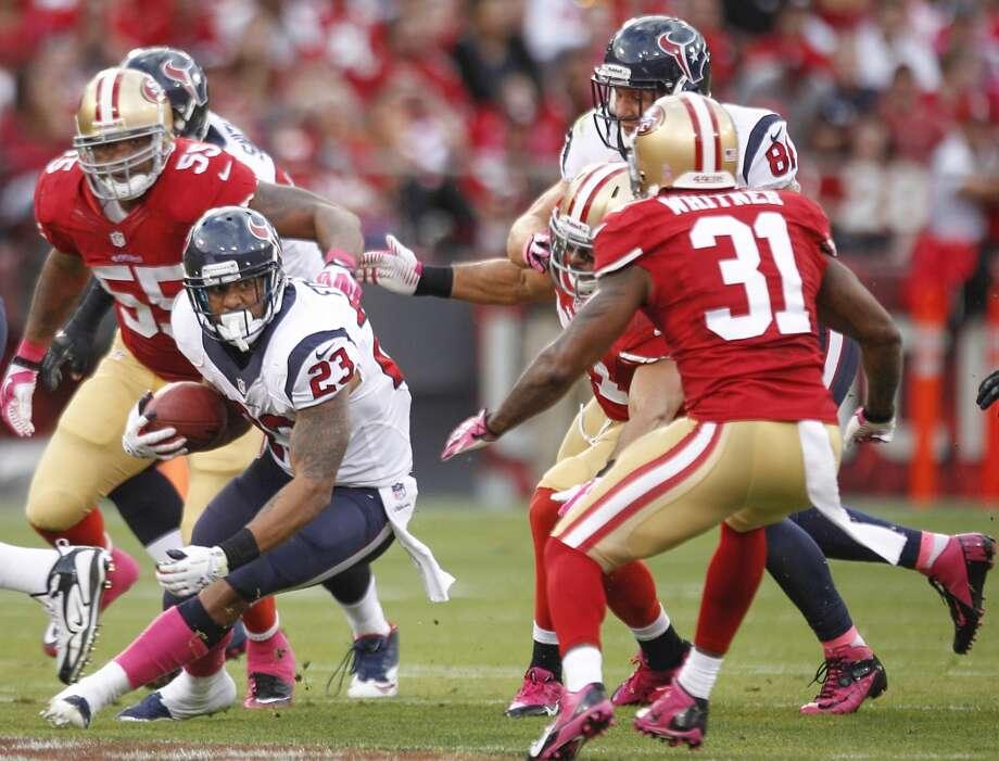 Texans running back Arian Foster looks for room to run against the 49ers defense. Photo: Brett Coomer, Houston Chronicle