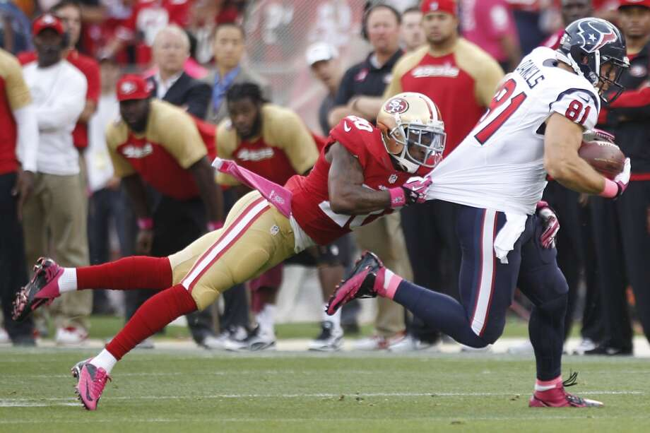 49ers defensive back Perrish Cox brings down Texans tight end Owen Daniels during the first quarter. Photo: Brett Coomer, Houston Chronicle