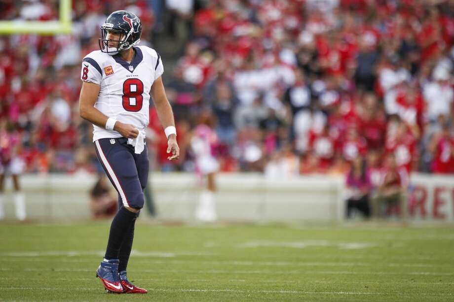 Texans quarterback Matt Schaub heads toward the bench during the second quarter. Photo: Brett Coomer, Houston Chronicle