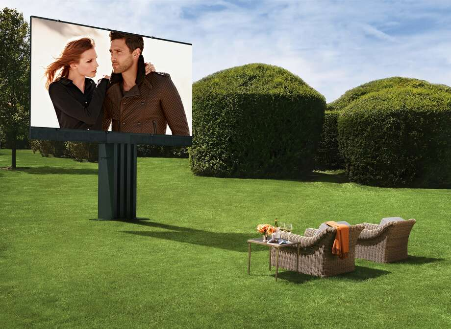 "This ""His and Hers"" outdoor entertainment system comes with a 201-inch screen that will emerge from your lawn, along with marine-grade speakers developed for super yachts. You also get a DirectTV satellite, DVD management system, a built-in movie package and two iPad minis that serve as remotes, all for $1.5 million."